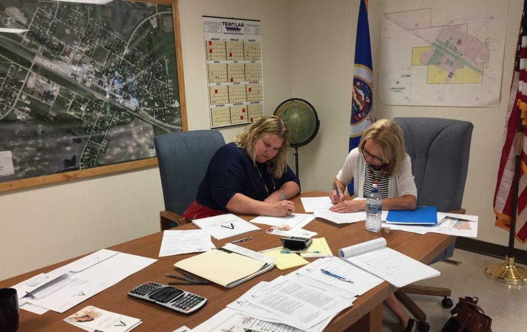 Linda Giersdorf and Kim Harkema signing grant award letter